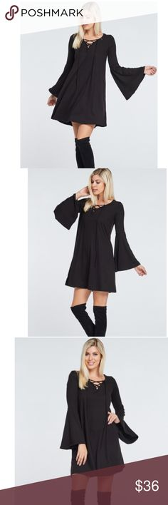 """""""All Laced Up"""" Dress This is one HOT dress!🔥 It features 2 huge trends this season - bell sleeves and a lace up neckline! Dresses"""