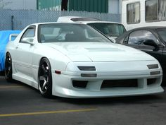 RX7: Ideally I'd want a triple rotor wankel engine to power my FC3S. If possible, triple sequential turbochargers.