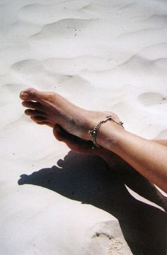 The feeling of sand between your toes <3