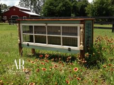 TV console made with an old window and shutters.