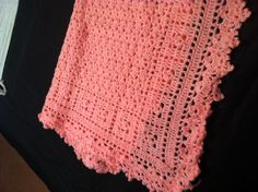 "Hot pink baby blanket which crocheted up with its own ""border"" of squares.  Pretty fast to make."