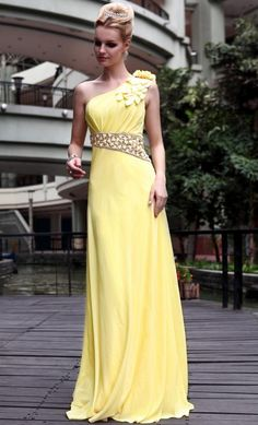 The bright clear colour and modern design makes this a dress that will give you a Wedding Party to be remembered. The design lines are simple but very elegant with off one shoulder styling and a graceful flared skirt. The bodice is gently draped and drops to a stunning jewelled band at the waist which reflects the light adding glamour and style. Imagine the bright yellow colour against your white Wedding Dress.