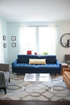 Mid century modern navy sofa and light gray rug... The dream!