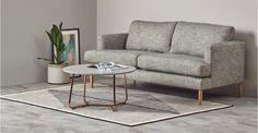 Nyla coffee table: Featuring a round silhouette and angled copper legs, this contemporary coffee table creates a flow of conversation and brings good vibes. Coffee Table Grey, Cool Coffee Tables, Coffee Table Design, Modern Coffee Tables, Living Room Plan, Living Room Decor, Contemporary Coffee Table, Table Dimensions, Cushions On Sofa