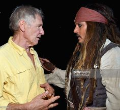 Actors Harrison Ford of STAR WARS: THE FORCE AWAKENS (L) and Johnny Depp, dressed as Captain Jack Sparrow, of PIRATES OF THE CARIBBEAN: DEAD MEN TELL NO TALES took part today in 'Worlds, Galaxies, and Universes: Live Action at The Walt Disney Studios' presentation at Disney's D23 EXPO 2015 in Anaheim, Calif.  (Photo by Alberto E. Rodriguez/Getty Images for Disney)