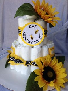 Mommy to Bee or Cute as can bee  2 tiered diaper cake with Baby Bee products via Etsy