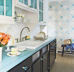 mini subway tile backsplash and the aqua pop inside the cabinets. Plus wallpaper.