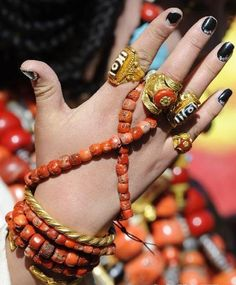 beautiful khampa tibetan girls in family's finery in qamdo .Coral and gold rings .bracelets.