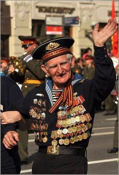 World War II Russian veteran wearing a Navy uniform with numerous orders and medals. 2013 May 9  the Victory Day in Russia.