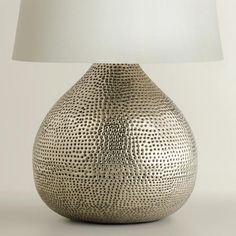 The round silhouette of our gorgeous Pewter Prema Punched Metal Table Lamp Base is full of texture and visual intrigue. The perfect size for an end table, buffet or nightstand, this affordable lamp ba Metal Table Lamps, Lamp Inspiration, Table Lamp Base, Table Lamp, Table Top Lamps, Table Lamps Living Room, Affordable Lamp, Lamp Bases, Living Room Redesign