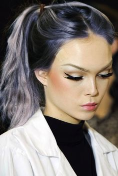 I'm loving everything about this look from the navy locks, to the emphasized cheek bones, to the near perfect, liquid eyeliner. Yes!!