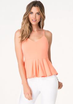 Solid Pleated Peplum Top - Scenemaker top in a lush jersey, featuring a feminine, fitted bodice and flared pleated peplum with a chic hi-lo design. Back hook-and-eye and exposed goldtone zip closure. Fitted Bodice, Women's Fashion Dresses, Dress Skirt, Night Out, Peplum, Camisole Top, Feminine, Tank Tops, Chic
