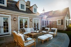 love the look of the four armchairs, ottomans, and sofa ... but think a sectional is really the right choice for our family + lifestyle: HGTV Dream Home 2015 - Patio with Ethan Allen Outdoor Lounge Furniture