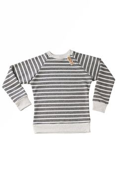 Now you can match your kids in our adult version button sweater. All seams are serged for a professional finish and added durability. Please refer to our size c
