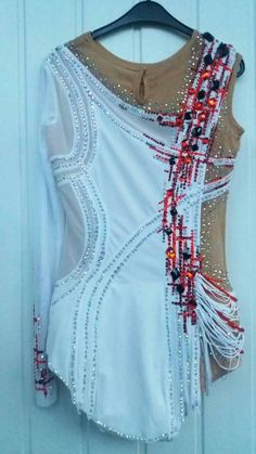 Beautiful designer rhythmic gymnastics leotard handmade, show as for examples of our work. The leotard for the rhythmic gymnastics competition made with over 2500 rhinestones sew-on rhinestones over 20 very high quality. If. you have any quastions let us know please. You can order