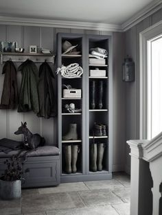 Stylish built-in storage is perfect for your shoes, hats and outdoor items. This charcoal grey unit from Neptune keeps it looking neat and stylish. Find more ideas at housebeautiful.co.uk
