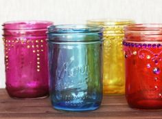 How to Make Colored Mason Jars. Use mog  podge one food coloring, coat the inside of jar with glue and food coloring