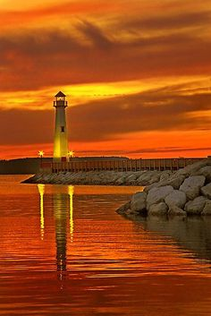 A enthralling Sunset in Wawatam Lighthouse in St. Ignace, Michigan #USAtravelguide #traveldestinations2015