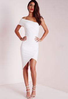 Look hot this weekend in this bodycon-tagious  midi dress. In figure flattering white fabric this asymmetric style dress is killer. With one shoulder detailing you'll be sure to have all eyes on you . Style with some barely there heels and ...
