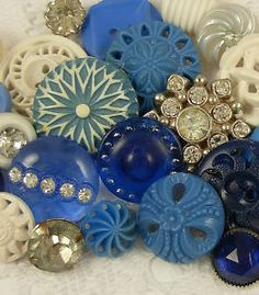 This reminds me of my great-grandmother.  I used to play in her vintage buttons.  Think I may add one to my dress for something blue.