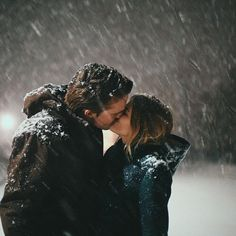 couple shares a kiss in the snow | relationship winter love