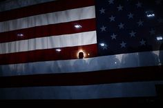 October 21, 2008 Supporters were seen through a U.S. flag as Republican presidential nominee Senator John McCain spoke during a rally at the Technology Creativity Manufacturing in Bensalem, Pa., on Tuesday. (Carlos Barria/Reuters)