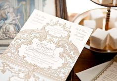 These ornate ivory and gold wedding invitations by Sweet Peony Press would be perfect for a Marie Antoinette inspired wedding.