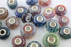 Hand made lampwork glass Beads lined with sterling silver (pandora style)