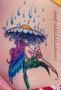10 Fascinating Fairy Tattoo Designs-Are you in love with the world of fairly tales? Then why not tell the world? Here are some perfect fairy tattoo designs that will do just that! A fairy tattoo design can have many adaptations. One such adaptation might be that of a fairy sitting under a flower, taking shelter from pouring rain. Colour could be added to make the tattoo look artistic and pretty.