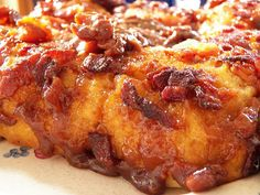 Maple Syrup-Bacon Biscuit Bake: a brown sugar/maple syrup bacon glaze is poured into the pan, then biscuits are placed on top & baked. Basically a cross between monkey bread & an upside down cake. Yum!