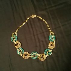 Nwot necklace Never worn necklace from target. Blue and a gold brown circular rings attached by gold rings. Beautiful necklace target Jewelry Necklaces