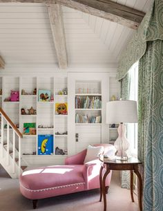 Chic Pink Girls Room Features A Shiplap Vaulted Ceiling Accented With Rustic Wood Beams Stand Over Wall Of Built In Bookcases Lined Placed