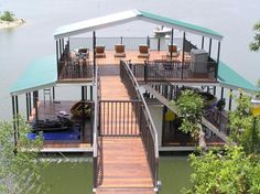 This cool boat dock has a large tanning sun deck on top.