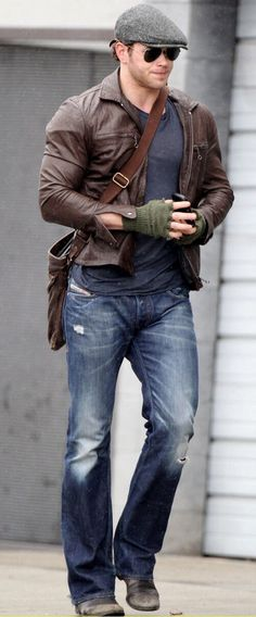 brown leather jacket. gray tee. jeans. boots. shades. messenger bag. comfortable. street. style.