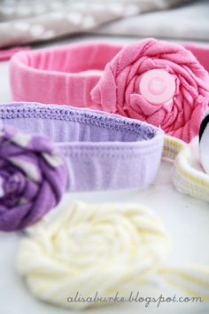 Upcycled baby headbands from their wastebands and DIY flowers :) via Alisa Burke