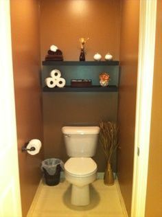 Like Shelf About Toilet And Also The Stick Arrangement As Decoration