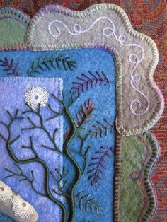 embroidery on pieced wool, love the border
