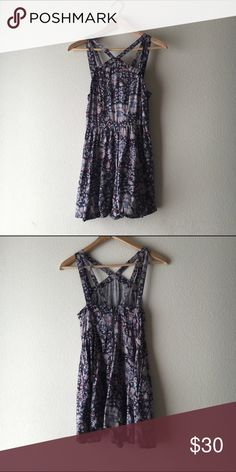 Kimchi Blue Floral Romper Urban Outfitters brand flowy romper (that looks like a dress when worn). Strap detailing and muted purple/blue coloring. Urban Outfitters Pants Jumpsuits & Rompers