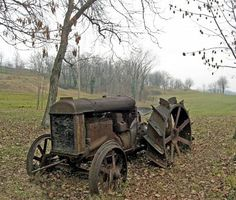 old rusty tractor abandoned in the countryside during the autumn