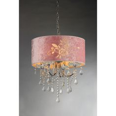 Add elegance to your home with the Dice crystal chandelier. This dynamic lighting element features generous rows of cascading crystals to catch the light and a pink shade with an etched rose.
