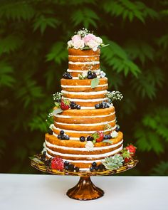Made by @gregmarshcakes, Bryce and Sydney's four-tiered naked #cake was in keeping with the Arcadian theme of their wedding. It sat on an amber glass pedestal, enwreathed by sugar-dusted berries and accented with tiny succulents and sprigs of baby's breath. See more details from the day, captured by @photosby_eande and styled by @iraandlucy, on our blog!