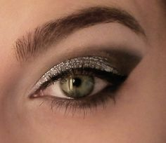 "start off with a creme silver palet, then use a brown powder on the brow line, followed by a black powder blended into a triangle...called ""paradise"""