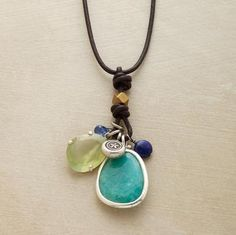 """A precious handful of kyanite, lapis, prehnite and amazonite, plus a silver flower charm are strung as a tassel on brown leather. Sterling silver toggle clasp. Exclusive. Natural stones will vary in size, shape and color. 19""""L."""