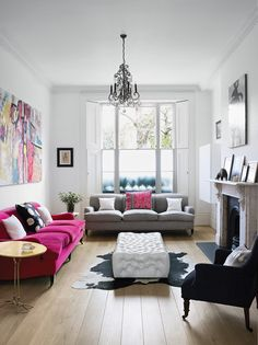white walls, pink sofa