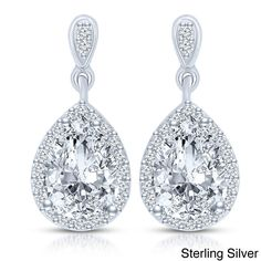 These fine drop earrings feature pear-cut clear cubic zirconia center stones outlined with smaller round-cut cubic zirconia. Crafted of .925 sterling silver, these earrings secure with butterfly clasps.