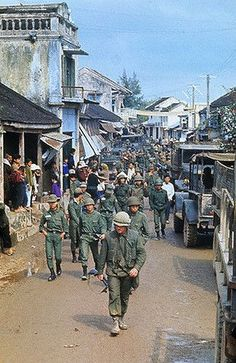 13 Feb 1968, Hue, South Vietnam --- U.S. Marines and South Vietnamese troopers on street with refugees soon to be evacuated. --- Image by © Bettmann/CORBIS: