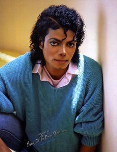 Michael Jackson Michael Jackson in a turquoise-colored sweater