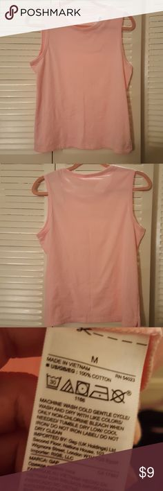 NWT GAP Pink Cotton Muscle Tank Top Size M NWT GAP Pink Cotton Muscle Tank Top Size M (medium). Brand new, never worn. 100% cotton. Very soft! Color is a baby pink. Check out my other GAP clothes for sale! Comes from a smoke free home, bundle and save!  *All my earnings will go towards helping the victims of hurricane Maria in Puerto Rico* GAP Tops Muscle Tees
