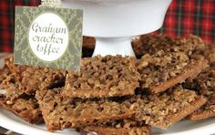 "Graham Cracker Toffee bars  24 cinnamon graham crackers broken into squares {you could also use regular flavored grahams}  1 cup unsalted butter  1 cup firmly packed brown sugar  1 cup finely chopped pecans {I use the small packets of pecan ""chips""}  Preheat oven to 350 degrees.  Line a jelly roll pan with aluminum foil and place the graham squared inside to fill the pan, in a single layer. In a sauce pan, melt butter and sugar together over medium heat. Once melted, increase heat to medium…"