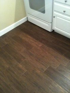 wood floor tile pattern. random pattern wood tile floor with white cabinet Proper for laying look porcelain tiles  Pay attention